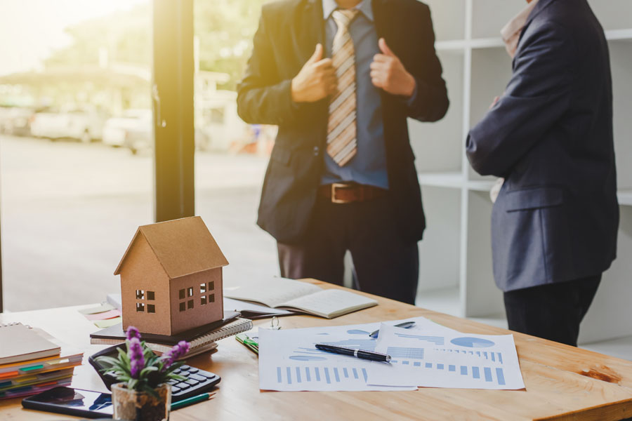 Real Estate Investor Insurance - Investors Talking About a Recent Real Estate Deal