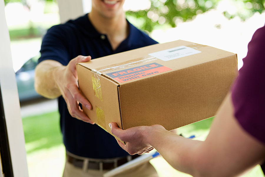 Parcel Delivery Contractor Insurance - Quick Delivery Man Handing a Package to a Homeowner
